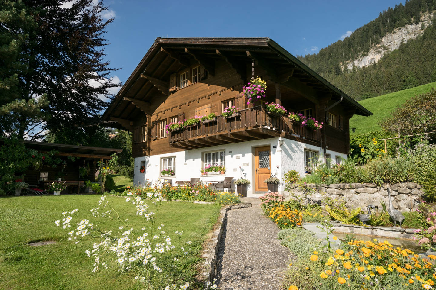 Apartment Gstaad Duplex Flat - Amazing Lake Chalet with pond photo 26018670